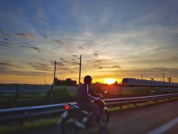 Road view during sunset. Travel Transportation Train Motorcyclist Motorcycle Sunset Sky Cloud - Sky Dramatic Sky Silhouette