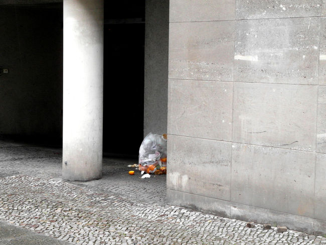Architectural Detail Beside The Road Bin Liner Concrete Concrete Wall Garbage Garbage Bag Garbage In The City Grey Greyscale Orange Orange - Fruit Orange Color Streetcorner Streetphotography