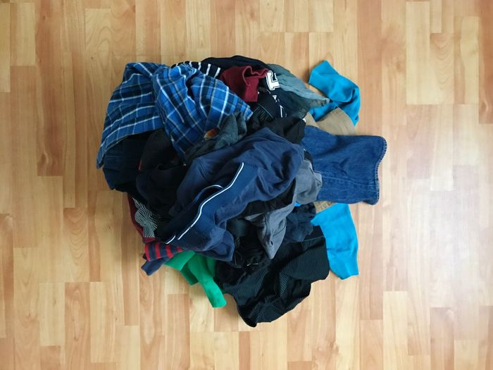 Heap Of Cloths On Hardwood Floor