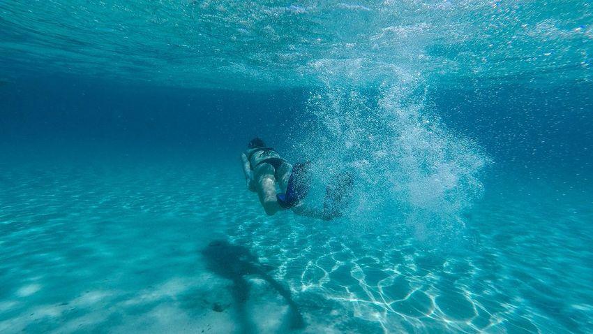 Underwater Sport Water Swimming Scuba Diving Adventure Aquatic Sport UnderSea Sea Leisure Activity Nature Lifestyles Exploration People Unrecognizable Person Blue Real People Outdoors Underwater Diving Snorkeling