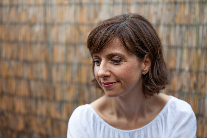 Woman Adult Bangs Beautiful Woman Brown Hair Close-up Day Emotion Females Fence Focus On Foreground Front View Hair Hairstyle Headshot Looking Looking At Camera Mature Adult One Person Portrait Smiling Woman Portrait Women
