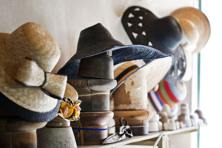 Arrangement Art And Craft Casual Clothing Choice Front View Full Frame Hat Hat Molds Lifestyles Metal Molds Order Real People Selective Focus Shear Side View Still Life Stone Variation Wooden Theshoparoundthecorner