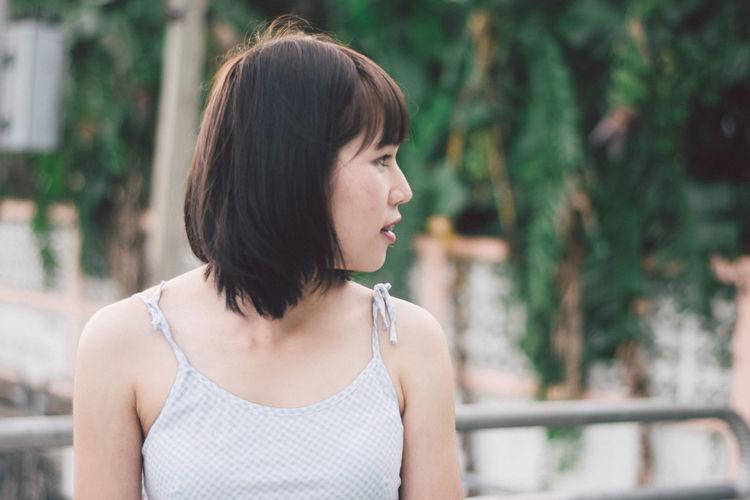 Young woman standing on bridge