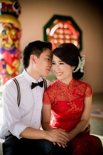Bride and bridegroom sitting on seat during wedding ceremony