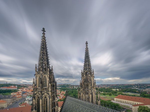 A view from the top of the tower of St Vitus Cathedral in Prague, including the Gothic towers of the church and a panoramic view of Prague. Architecture Architecture Building Exterior Built Structure City Cityscape Cloud - Sky Czech Republic Day Europe High Angle View Of Prague Historical Building History Long Exposure No People Outdoors Place Of Worship Prague Religion Sky Spirituality St Vitus Cathedral Steeple Travel Travel Destinations