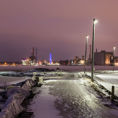 Wintery cityscape of Vaasa, Finland, as seen from a marina at Vaskiluoto island Architecture City Cityscape Cold Temperature Electricity Pylon Ice Landscape Night No People Power Plant Purple Sky Pylons Slippery Squarecrop Tower Urban Skyline Vaasa Winter Lost In The Landscape