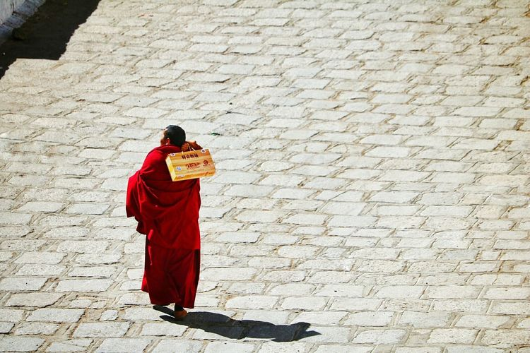 High Angle View Of Monk Walking On Street