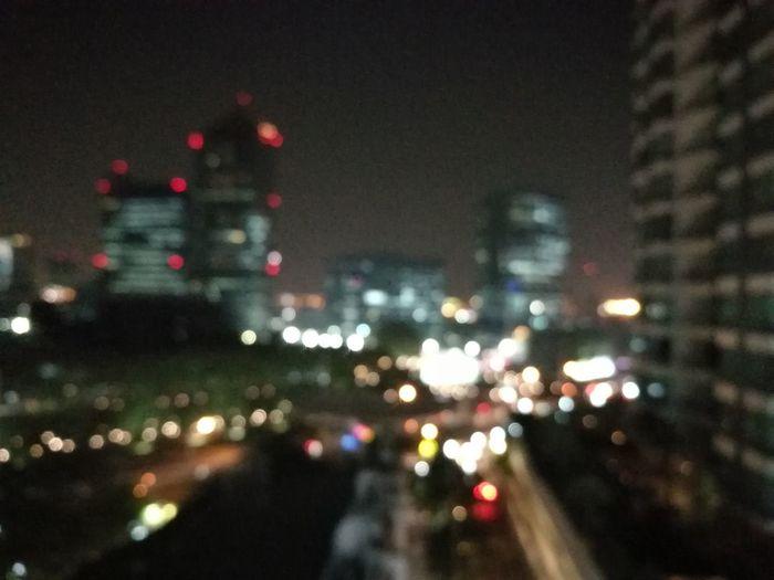 Close-up of illuminated cityscape against sky at night