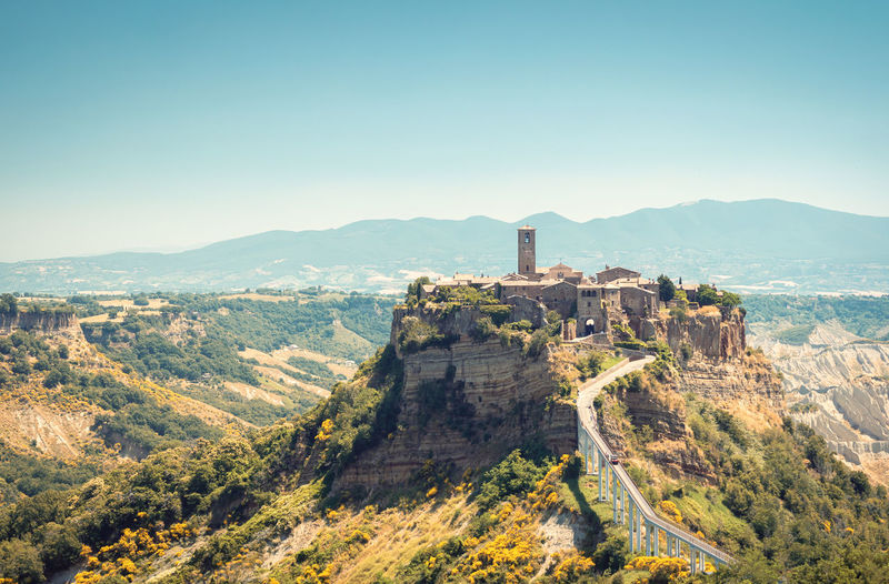 Civita di bagnoregio, an antique town in the countryside of central italy, perched on top of a hill