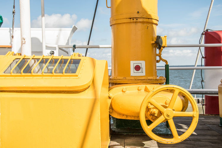 """Detail from """"Feuerschiff"""" Cuxhaven Feuerschiff Fireship Yellow Color Yellow No People Tubes Window Metal Iron Wheel Valve Pipe Pipes Ship Boat Water Sea Sea And Sky Seaside Deck Vessel Craft Detail North Sea Cuxhaven Miles Away 10"""