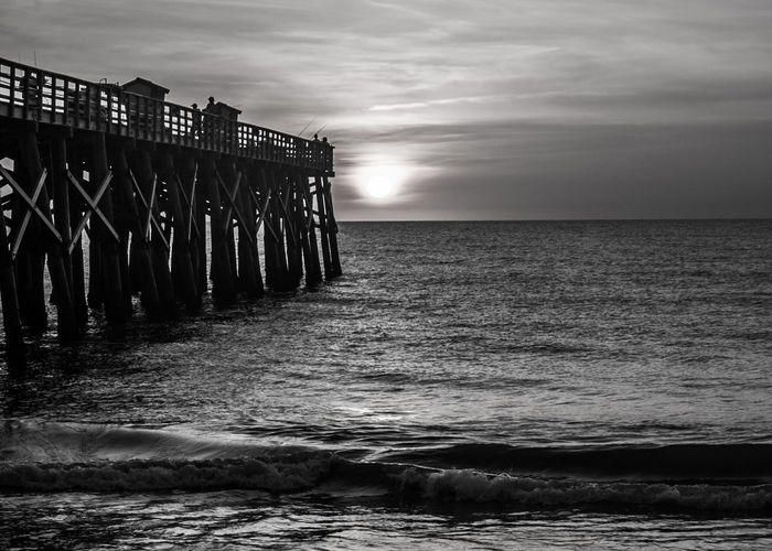 Flagler Beach, Florida Flagler Pier Architecture Beach Beauty In Nature Black And White Photography Built Structure Cloud - Sky Florida Groyne Horizon Horizon Over Water Land Motion Nature No People Scenics - Nature Sea Sky Sunrise Sunset Tranquil Scene Tranquility Water Wave Wooden Post