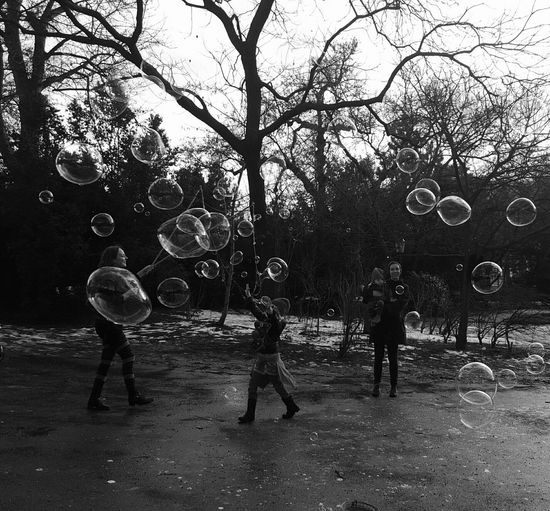 Real People Lifestyles Bubble Outdoors Tree Togetherness People Bubble Wand Nature Blackandwhite Photography Black And White Photography Black And White Black & White Best Of EyeEm Bubbles Bubbles... Bubbles...Bubbles.... Bubbly Bubles Fun Park Life Tree Park Bub Nature Day