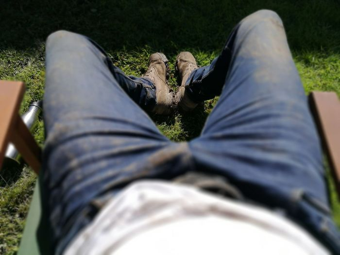 EyeEm Selects Resting after hard labour Jeans Relaxation One Man Only Sitting Landscape Gardening Dirty Jeans Worker Mud Boots Muddy Boots Legs Labourer Hard Working Hard Work Worn In Tshirt Breaktime Lunch Break Rest Summer Sunset Dusk Sundown Dusk In The Country