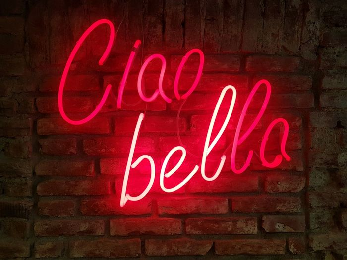 Ciao bella! Communication Text Illuminated Wall Minimalism Neon Words Red Bye Bye Streetphotography Store Sign Commercial Sign Electric Light Neon Colored Fluorescent Light Bulb Lighting Equipment Billboard Store Window Capture Tomorrow