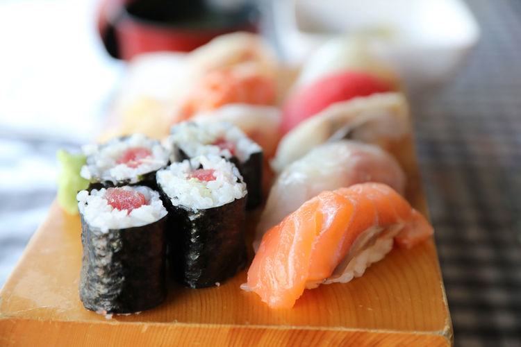 Sushi Japanese Food Seafood Rice Food Food And Drink Freshness Asian Food Healthy Eating Ready-to-eat Fish Wellbeing Indoors  Focus On Foreground Rice - Food Staple Still Life Salmon - Seafood Caviar Sashimi  Tray Temptation