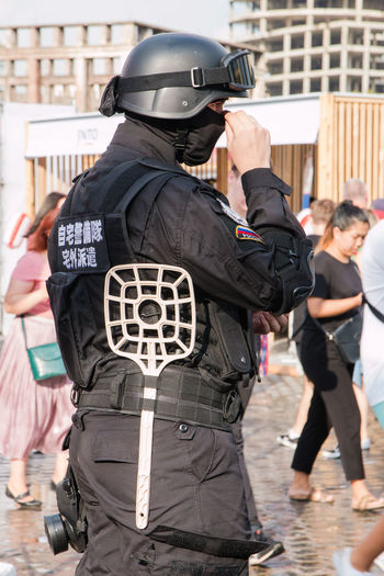 Cosplay Authority Clothing Day Government Group Of People Headwear Helmet Holding Law Men Occupation People Police Force Police Uniform Protection Rear View Safety Security Standing Uniform
