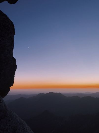 Scenic view of silhouette mountains against clear sky