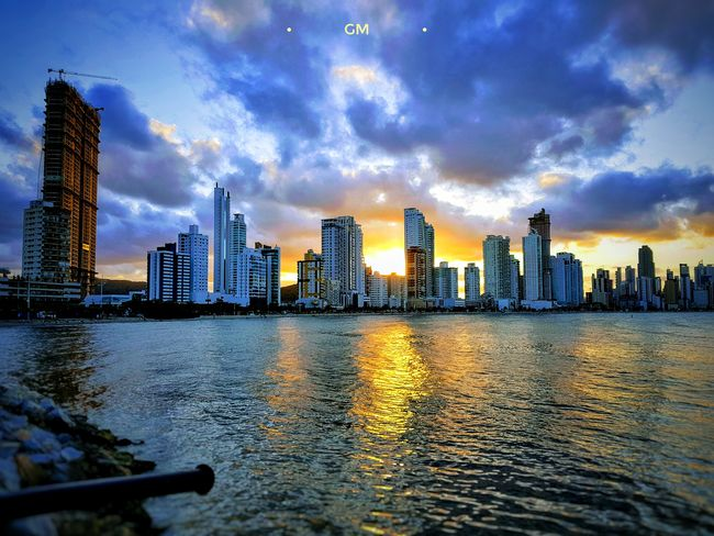 Architecture Skyscraper Building Exterior City Modern Sky Cityscape Urban Skyline Cloud - Sky Built Structure Water River Sunset Waterfront Travel Destinations Outdoors No People Day