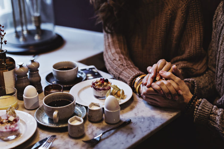 Woman and coffee cup on table