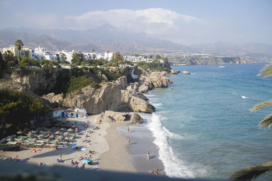 Calahonda, one of the coolest beaches in Andalucia, Spain! Andalucía Beach Life Beach Photography Mountians Nature Nerja SPAIN Summertime Tropical Paradise Vacations Beach Calahonda Mountain Range Ocean Resort Sea Sea And Sky Summer Tourism Tourist Destination Tropical Vacation