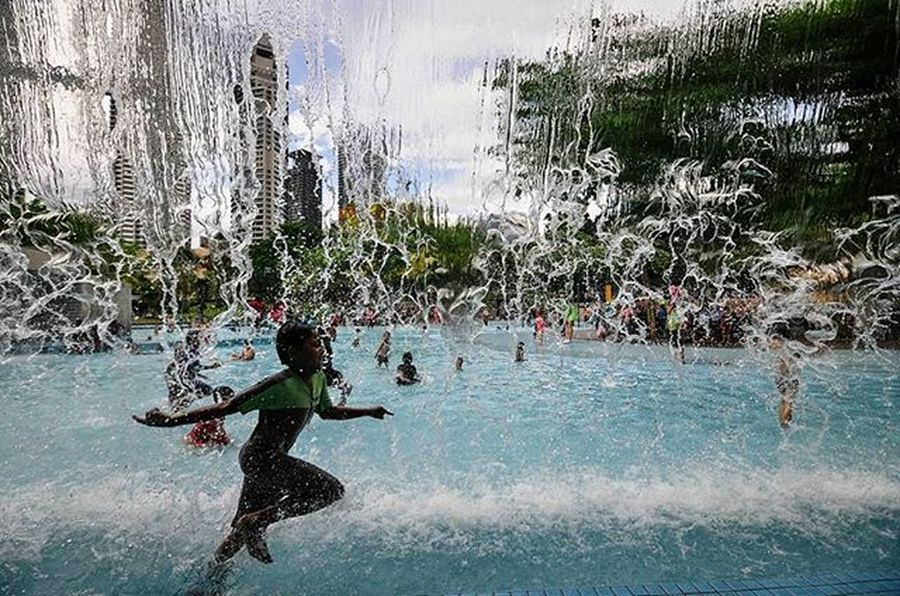 a boy enjoying a water theme park in the City at the weekend to spend time with family Vscocam VSCO Vscomalaysia Amalaysianphoto Mshjournal Found On The Roll