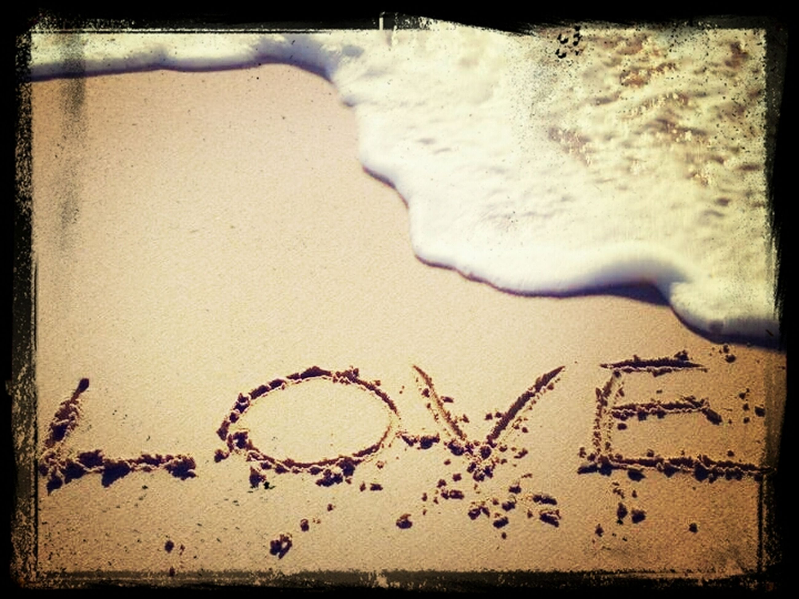 transfer print, auto post production filter, text, sand, western script, beach, high angle view, communication, close-up, heart shape, shore, no people, day, outdoors, love, vignette, capital letter, footprint, wall - building feature, bicycle