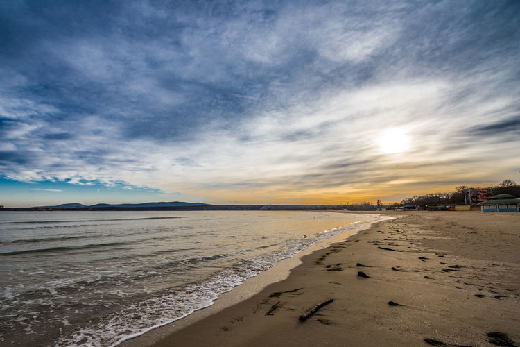 Beutiful and coloeful winter sunset with dramatic clouds on the sea. Dramatic Sky Winter Sea Beauitiful Sunset Beautiful Sea View Beautiful Seascape Beauty In Nature Dramatic Clouds Dramatic Landscape Dramatic Skies Dramatic Sky At Sunset Time Winter Sunset