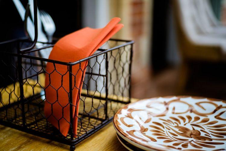 Close-up of orange slice in basket on table