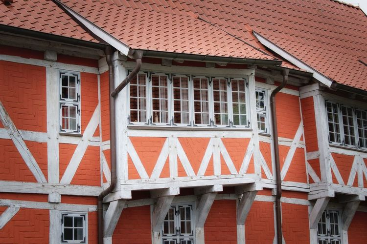 Architecture Built Structure Building Building Exterior Window House Roof Residential District Day No People Red Outdoors City Low Angle View Communication Roof Tile Flag Orange Color Nature Text Row House Bridge House