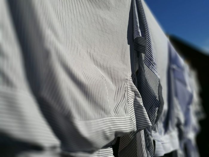 Close-up of shirts hanging outdoors