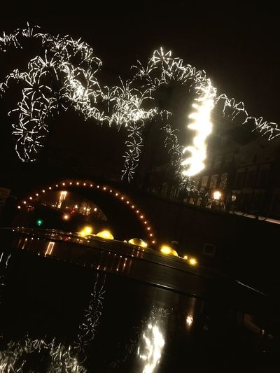 Light Spider eating a bridge Canal Amsterdam Night Illuminated Glowing Water No People Nature Lighting Equipment City Reflection