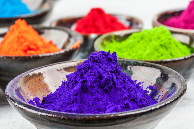 Close-up of colorful powder paints in bowls