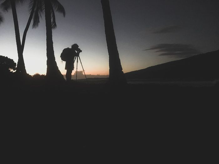 Silhouette One Person Real People Sunset Photography Themes Men Nature Photographer Occupation Camera - Photographic Equipment Tree Standing Photographing Technology Sky Outdoors Beauty In Nature People