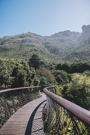Beauty In Nature Bridge - Man Made Structure Clear Sky Day Footbridge Mountain Mountain Range Nature No People Outdoors Railing Sky Tranquil Scene Tranquility Tree