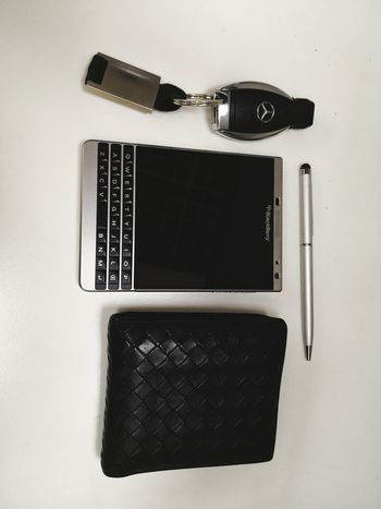 phone Technology Wireless Technology Indoors  Portable Information Device Mobile Phone Connection Camera - Photographic Equipment Day Computer Keyboard White Background Computer No People Close-up Table Keyboard