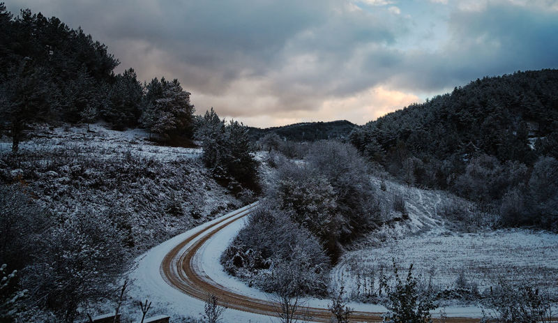 Winter in Bolu Beauty In Nature Cloud - Sky Cold Temperature Day Dirt Road Hills And Valleys Hillside Icy Mountain Nature No People Outdoors Paths Pathway Sky Sky And Clouds Snow Snowy Mountains Tranquility Tree Trees And Sky Winding Path Winding Road Winter Trees Wintertime