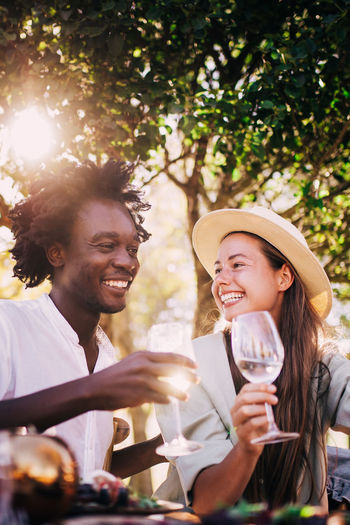 Happiness Smiling Togetherness Two People Emotion Drink Women Food And Drink Young Adult Adult Glass Bonding Young Women Leisure Activity Refreshment Friendship Alcohol Young Men Enjoyment Teeth Positive Emotion Couple - Relationship Drinking Outdoors