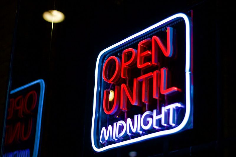 Illuminated Neon Night Text Lighting Equipment Communication Business Sign Open Sign Dark Glowing Red No People Retail  Open Nightlife Blue City Commercial Sign Western Script Black Background Consumerism Economy Neon Colored