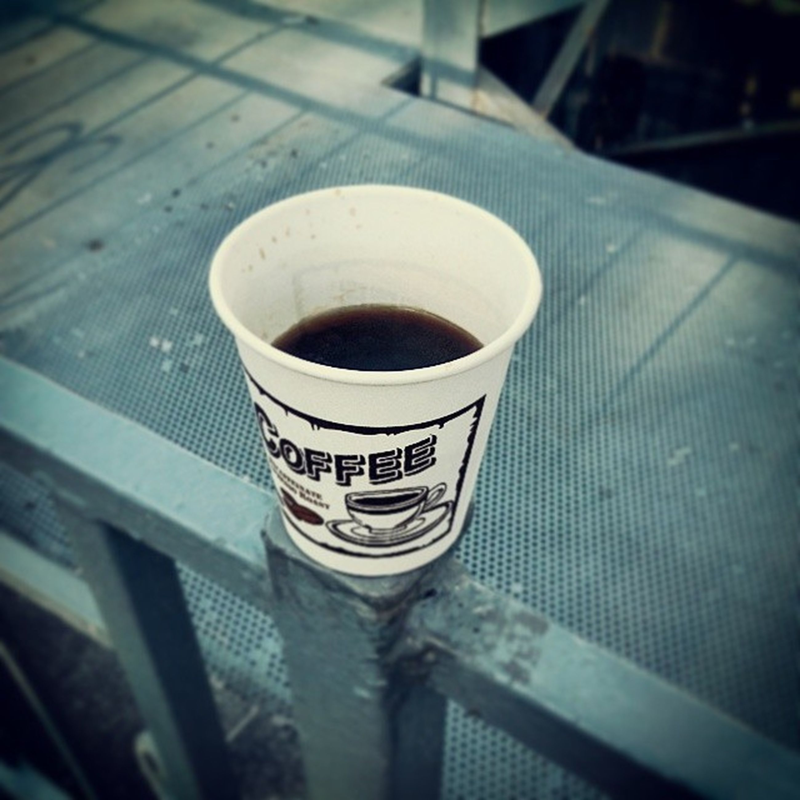 close-up, drink, indoors, focus on foreground, refreshment, still life, coffee cup, no people, built structure, architecture, table, day, metal, selective focus, food and drink, freshness, low angle view, building exterior, coffee - drink