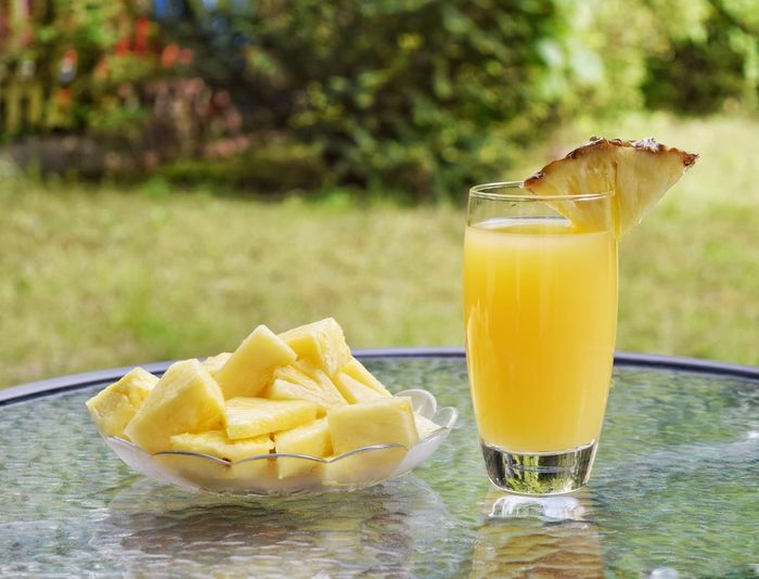 Close-up of yellow juice on table