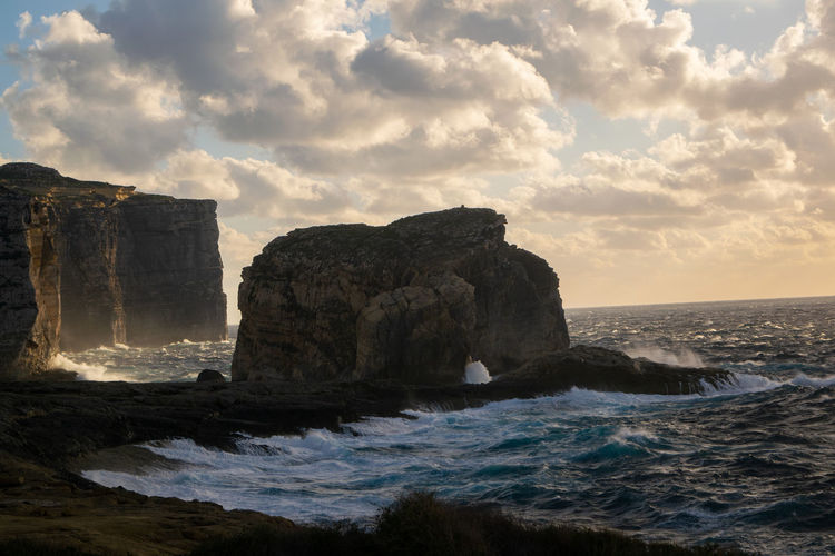 Lone rock in a sea 2 Sea Water Sky Rock Beauty In Nature Scenics - Nature Cloud - Sky Nature Land Beach No People Outdoors Hill Cliff Ocean Island Malta Horizon Over Water Motion Wave Rock Formation Solid Eroded Power In Nature Stack Rock