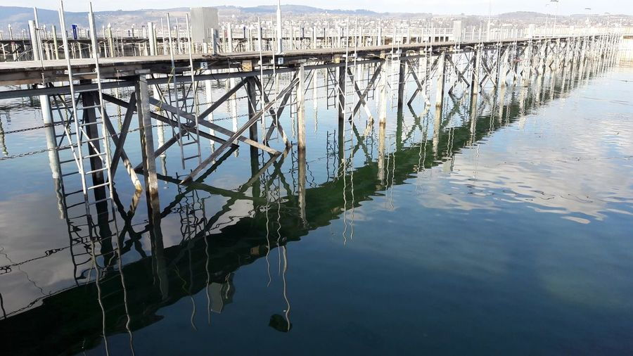 Water Lake Day No People Outdoors Sky Harbour Reflections Sunlight Shilouette Bridge - Man Made Structure Boatbridge Winter Lake Constance