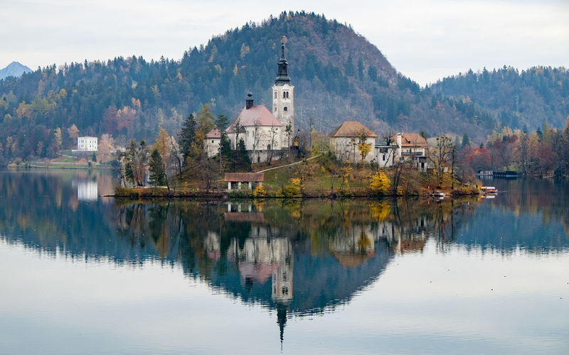 Reflection of santa maria church on lake bled
