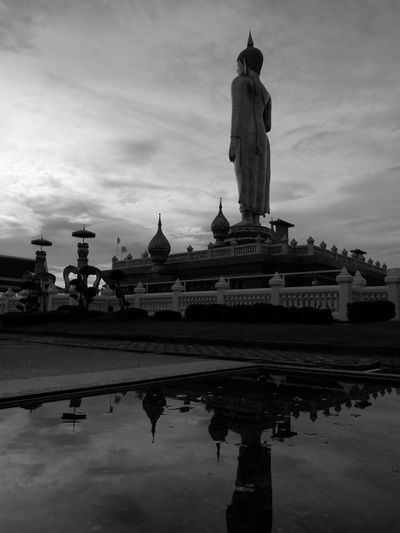 The Standing Buddha image style the largest in the South of Thailand. Buddha Statue Buddhas Famous Place Sky Reflection Cloud Monument Cloud - Sky History Waterfront Vacations The Past Outdoors Pedestal