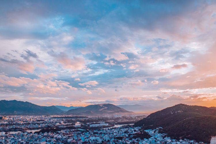 Nha Trang cityview on sunset Architecture Beauty In Nature Cloud - Sky Environment Idyllic Landscape Mountain Mountain Range Nature No People Non-urban Scene Outdoors Remote Scenics - Nature Sky Sunset Tranquil Scene Tranquility Water