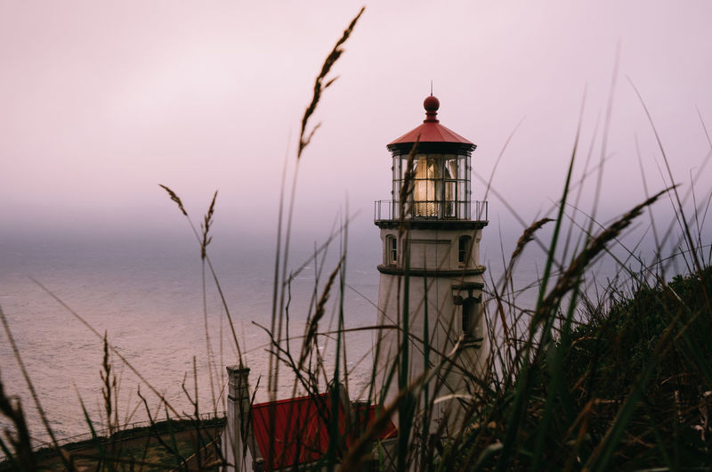 Oregon Oregon Coast Pink Sky Sunset Lighthouse Oregon Lighthouses Sky Pacific Northwest  Architecture Tower Nature Built Structure Building Exterior Water Plant Sea Building No People Guidance Beauty In Nature Protection Security Tranquility Grass Outdoors