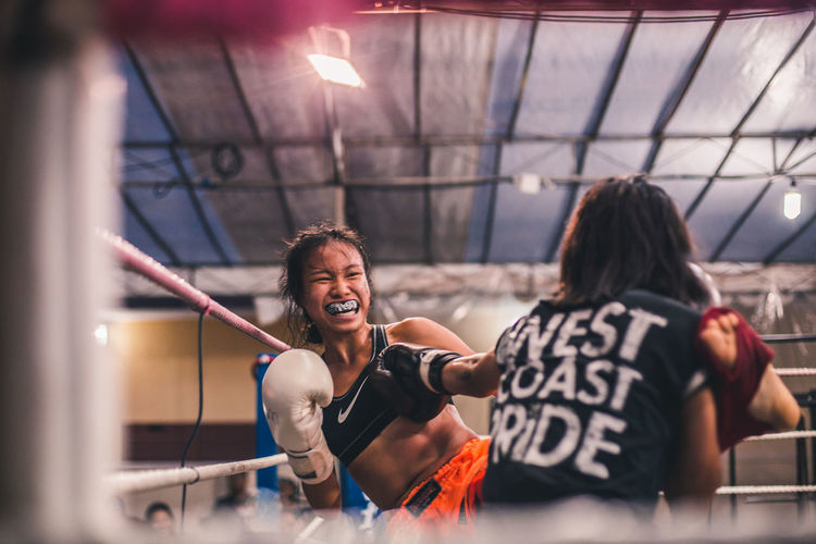 Effort. International Women's Day 2019 Real People Two People Lifestyles People Women Young Adult Emotion Effort Vitality Fitness Young Women Sportswoman Kickboxing Muay Thai Strength Kicking