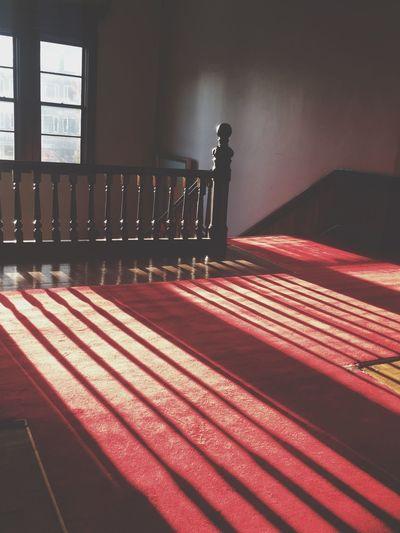 Shadow of railing on corridor