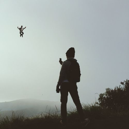 Man in mid-air falling performing stunt