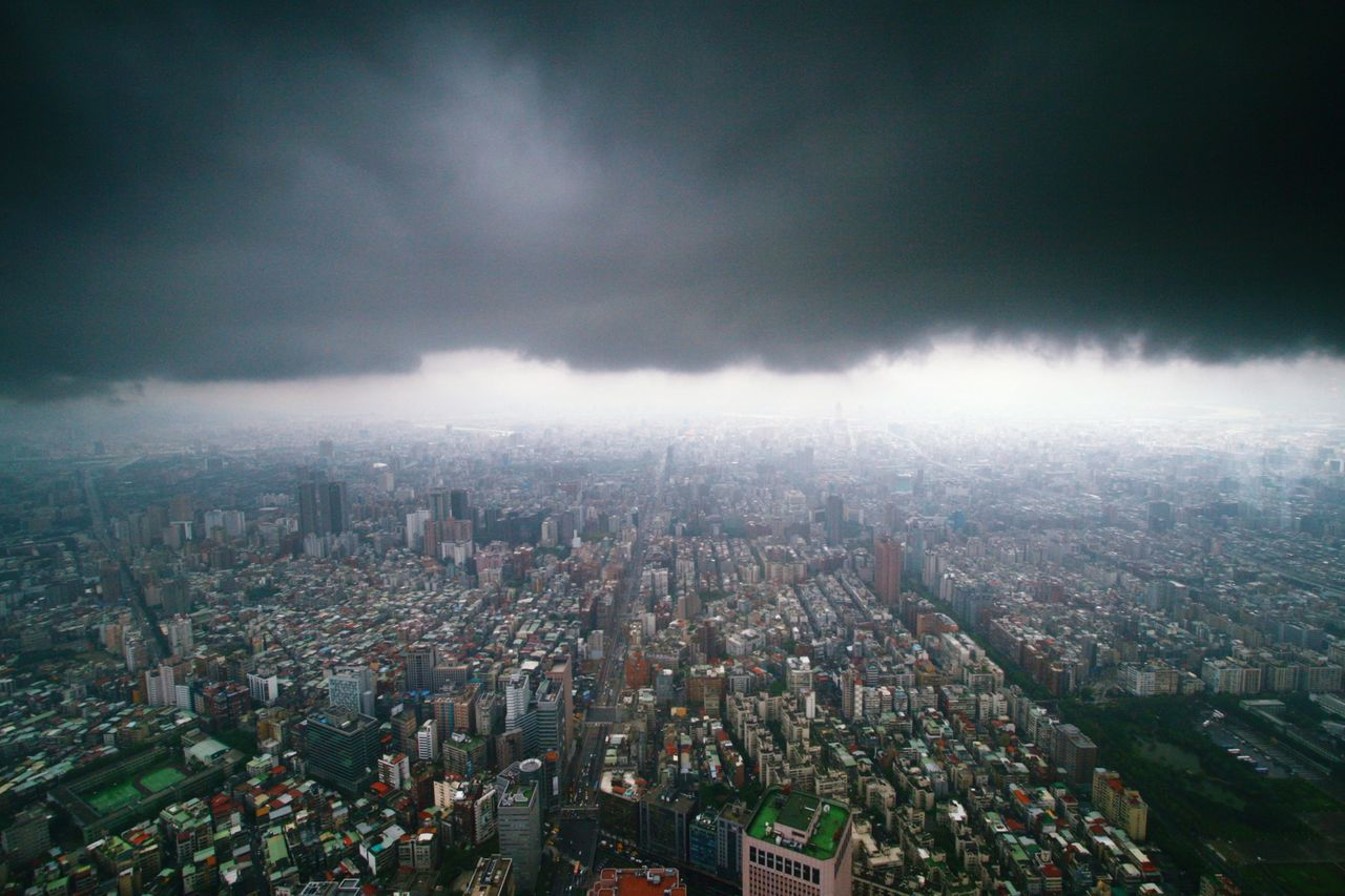 Cityscape against storm clouds
